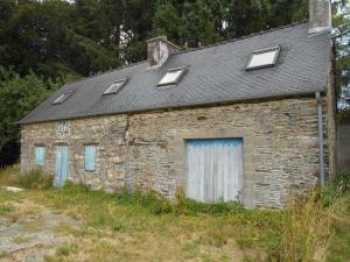 AHIB-2-JS2502 St Mayeux 22320 Stone house to renovate on 5648m2 grounds. Quiet country setting.