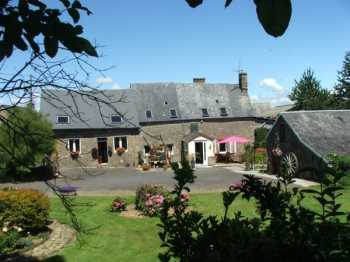 AHIB-4-SIF-00890 Melle 35420 Attractive Breton Longère with attached gîte and outbuildings standing in a pretty, well-established 2500m2 garden and views over open countryside.